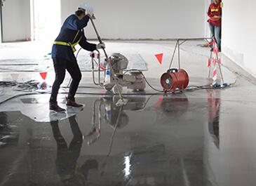 contractor painting epoxy flooring